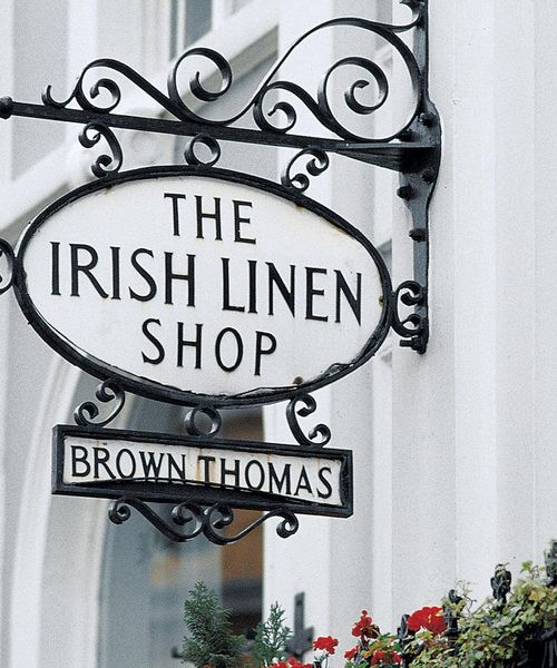black metal sign for shop saying the irish linen shop