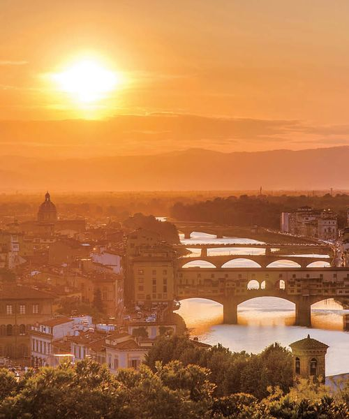 panorama of arno river in florence italy at sunset