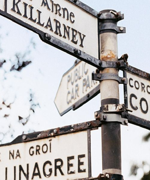 metal street sign with directions to cork and killarney
