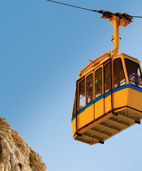 yellow and blue cable car in rosh hanikra israel