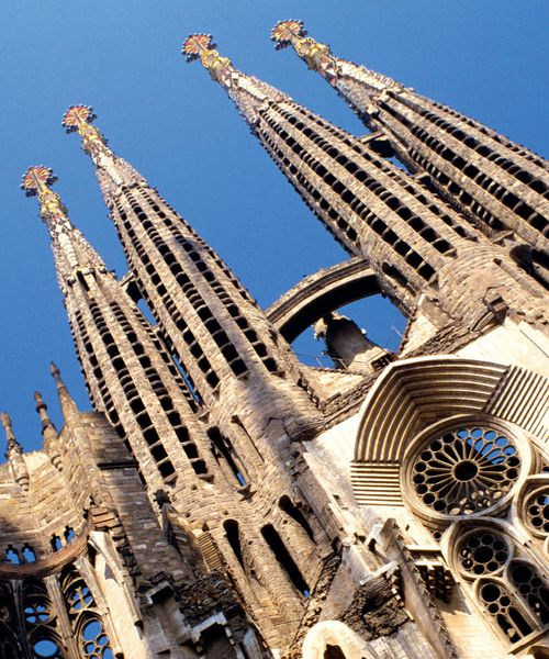 low angle view of sagrada familia in barcelona spain with blue sky