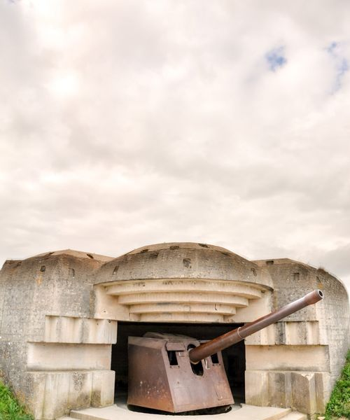 remains of german artillery at arromanches les Bains beach normandy france