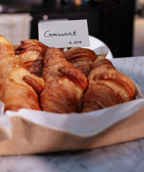 croissants in a basket being sold in paris france