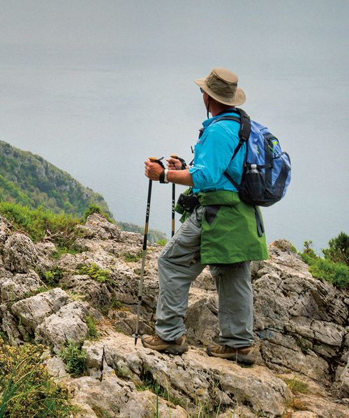 a person hiking along the path of the gods trail in amalfi italy