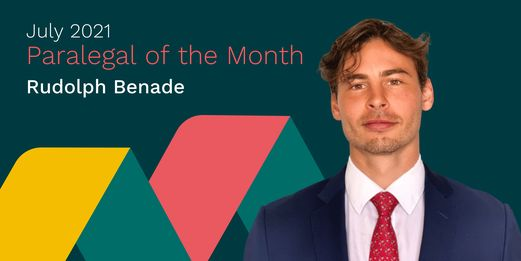 Rudolph Benade, Paralegal of the Month, smiles at the camera. Behind him, the edges of the Flex Legal branding lightly caress his shoulders.