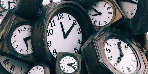 A pile of wooden clocks