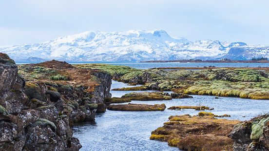 rocky landscapes and glacial lakes in iceland with mountains