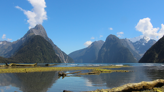 waters of milford sound with cliffs and blue sky