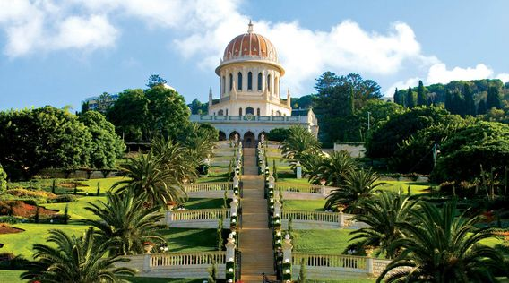 looking up at the golden dome of the bahai and gardens in israel