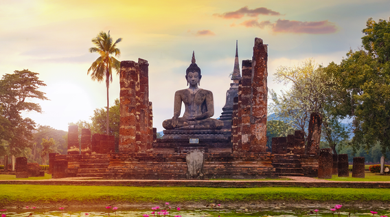 a large buddha statue in sukhothai historical park