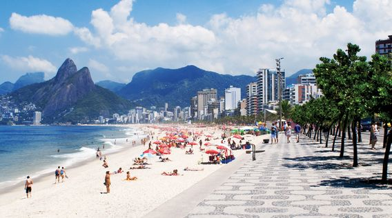 palms and two brothers mountain with people on ipanema beach in rio de janerio brazil