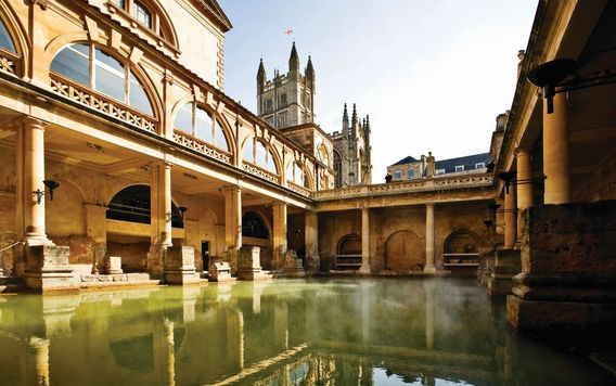 the roman baths surrounded by temple in bath england