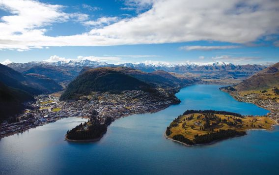aerial view of queenstown on a partly cloudy day