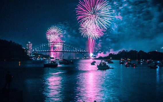 fireworks over the harbor in sydney australia during new years eve