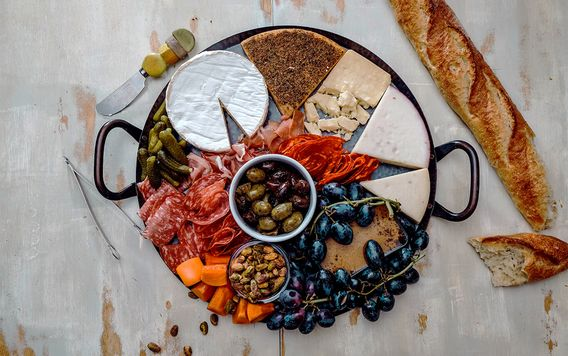looking down at a charcuterie board filled with meats and cheeses
