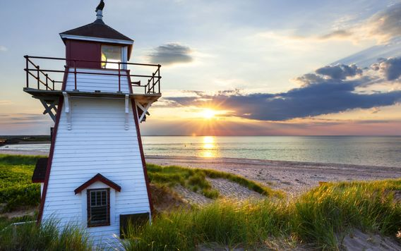 covehead harbour lighthouse on prince edward island in canada at sunset