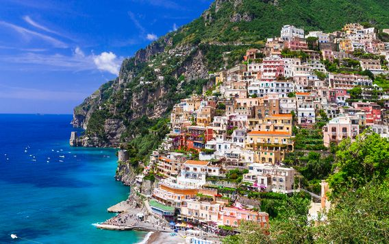 colorful building going up a hill along the amalfi coast in italy