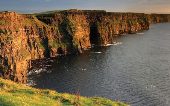 cliffs of moher in galway ireland at sunset