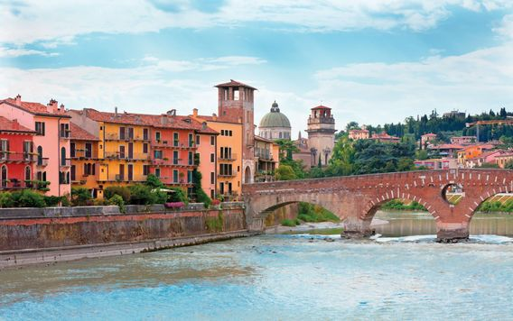 red brick bridge crossing over river in verona italy