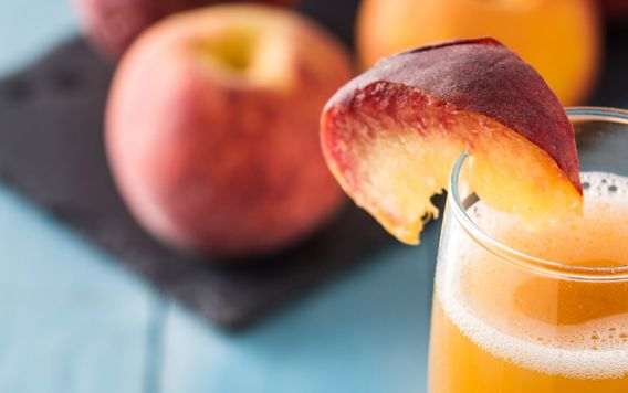 peach slice on rim of peach bellini