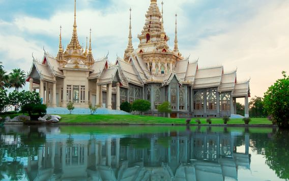 church in thailand reflecting in the water