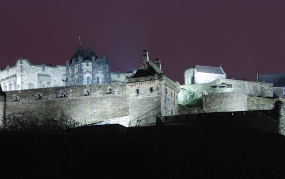 edinburgh castle lit up at night in scotland