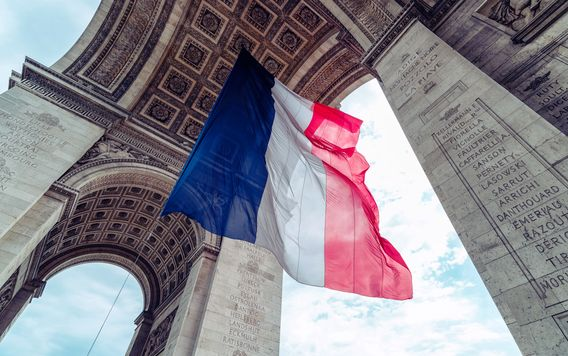 france flag dangling from arc de triomphe de letoile