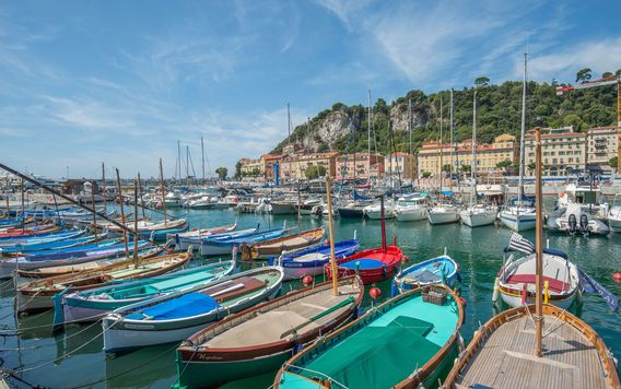 colorful boats docked in a marina in the french riviera
