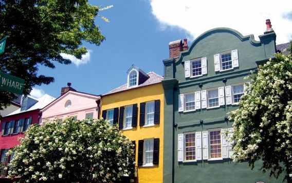 green and yellow buildings on rainbow row in south carolina