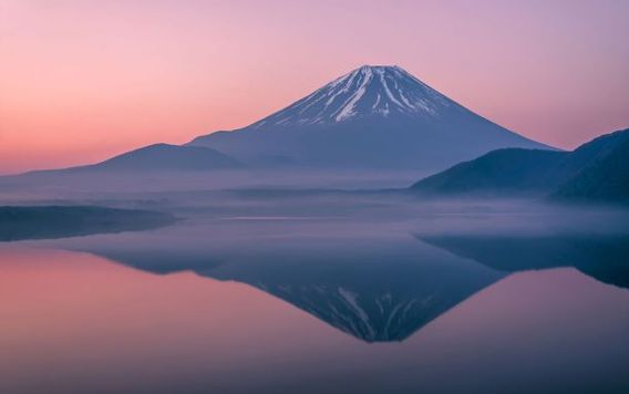 mount fuji in japan at sunset with reflection on water