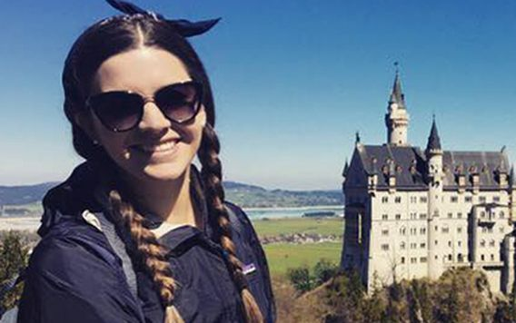 traveler katie with view of neuschwanstein castle in germany
