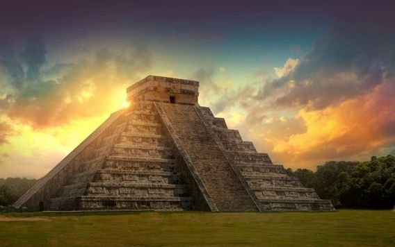 pyramid of kukulcan in mexico at sunset
