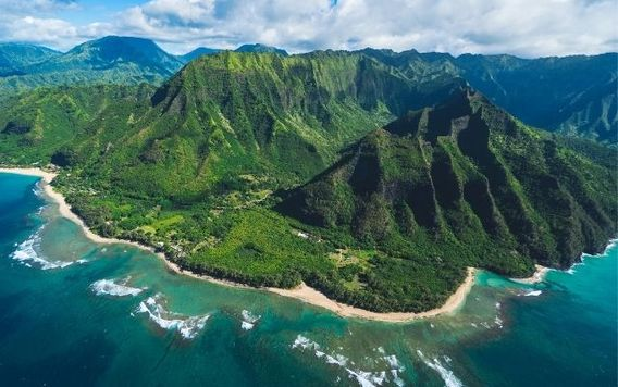 aerial view of mountain along coast in kauai hawaii