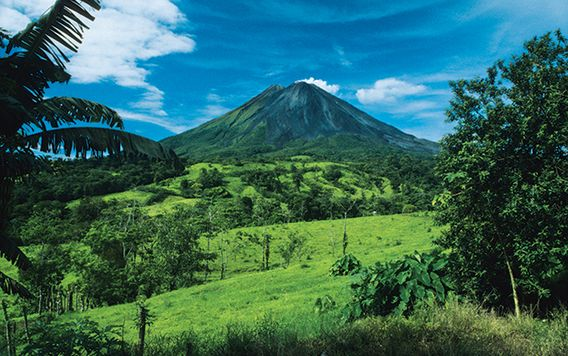 arenal volcano surrounded by jungle in costa rica