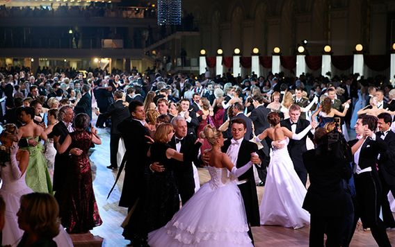 people dancing in big room at a ball in vienna