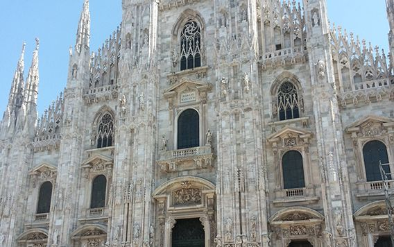 people walking in front of milan duomo cathedral church in italy