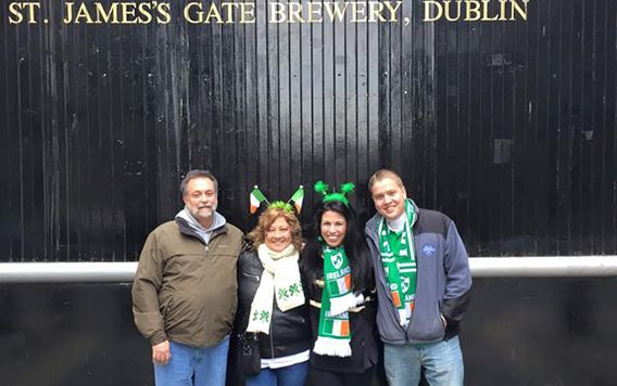 travelers dressed up for st patricks day in front of guiness sign in dublin irelad