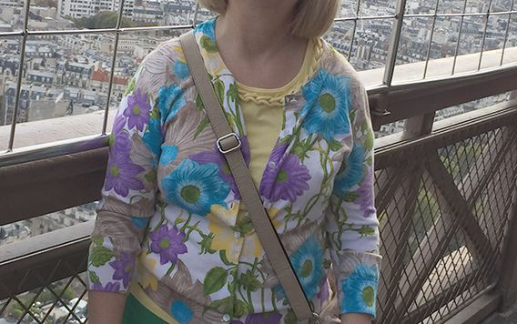 traveler jodie standing at edge of eiffel tower in paris france