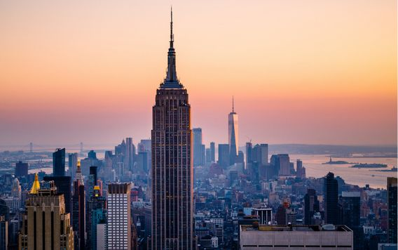 sunset over manhattan skyline in new york city