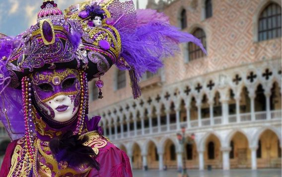 person wearing purple and gold costume and mask in venice italy