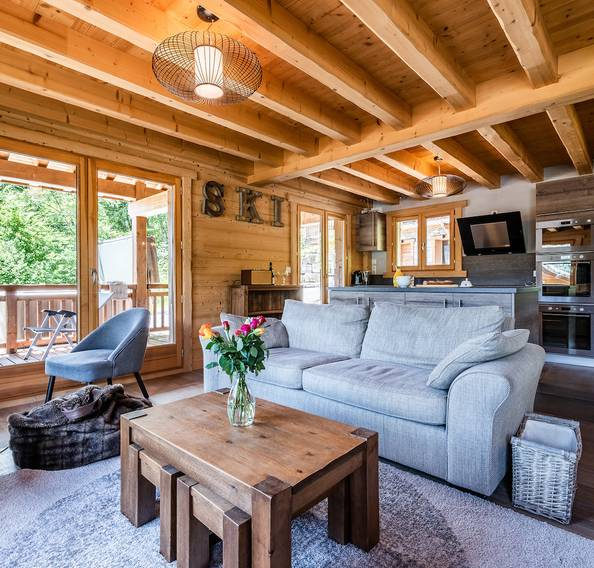 Modern living room with wooden walls at Balata luxury chalet in Morzine