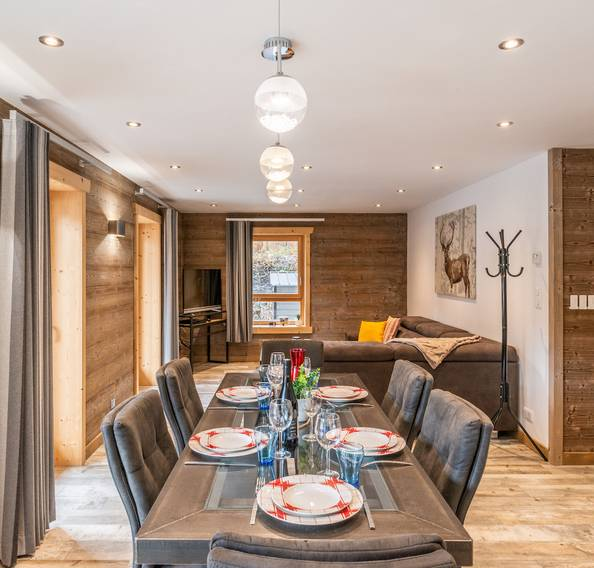 Modern dining room with kitchenware at Ourson accommodation in Morzine