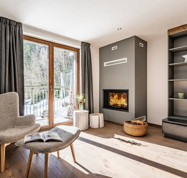 Reading corner and fireplace at Badi luxury chalet in Chamonix