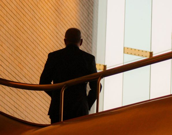 A man from behind in a modern building