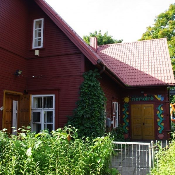 red wooden house with garden