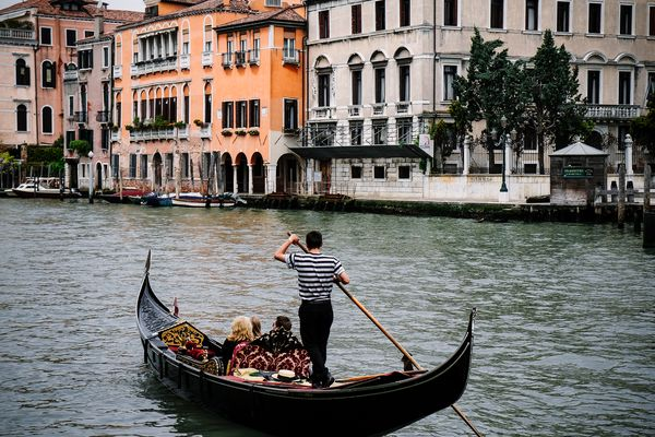 Gondola in a canal in Venice