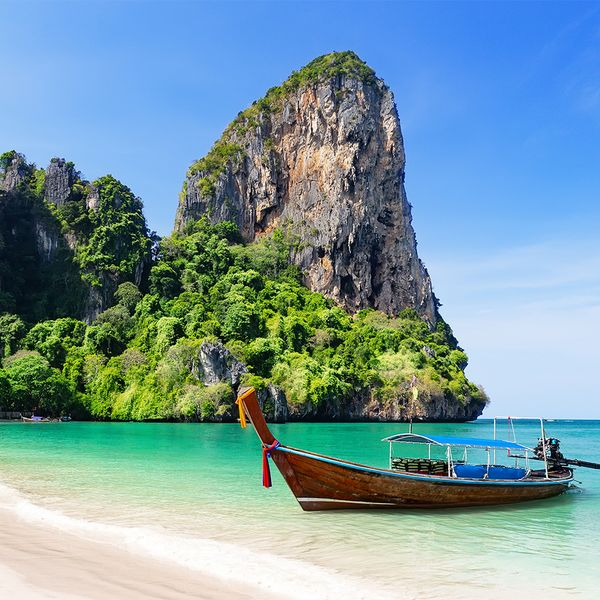 Thai traditional wooden longtail boat and beautiful sand on a beach in Thailand