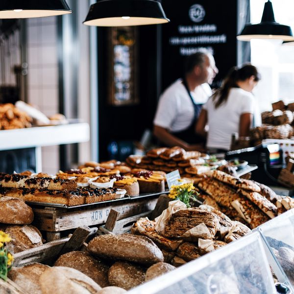 Breads and pastries for sale at counter inside cafe in Amsterdam
