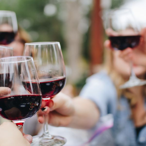 Travelers cheers with glasses of French wine