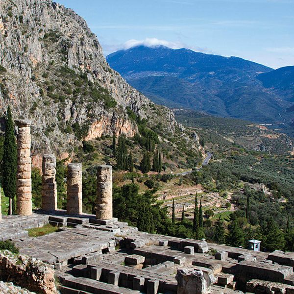 temple of apollo surrounded by mountains in delphi greece
